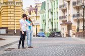 Girl and guy on street of European citiy. — Foto Stock
