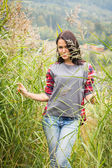 Girl in casual clothing in high grass — Stock Photo