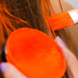 Makeup artist paints hair in orange — Stock Photo #60983369