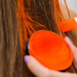 Makeup artist paints hair in orange — Stock Photo #60983383
