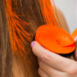 Makeup artist paints hair in orange — Stock Photo #60983417