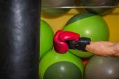 Boxing glove hit a punching bag — Stock Photo