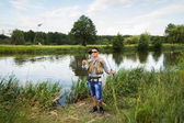 Fisherman holding a perch in hand — Stock Photo