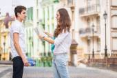 Couple walking along the street — Stock Photo