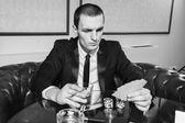 Poker player in the casino — Stock Photo