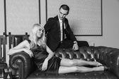 Man and woman on sofa — Stock Photo