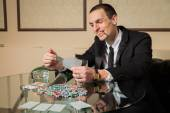 Poker player in the casino — Stock Photo