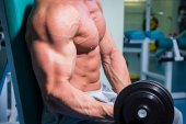 Strong man in the gym — Stock Photo