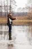 Man fishing in the river — Stock Photo