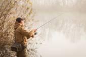 Fisherman on the autumn background. — Stock Photo