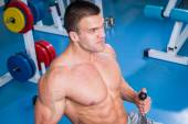 Man working out with weights — Stock Photo