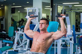 Man doing exercises in gym — Stock Photo