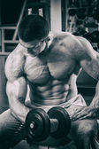 Man working out with dumbbells — Stock Photo