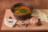 Oriental Soup with bread — Stock Photo