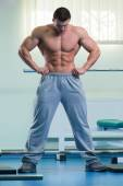 Man doing exercises with a barbell in the gym — Stock Photo