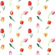 Seamless pattern of watercolor pink, red and yellow tulips. — Stock Photo #65124931
