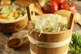 Sauerkraut in a wooden barrel — Stock Photo