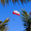 Parachute against blue sky — Stock Photo #53093777