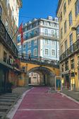 Narrow street in Lisbon — Stock Photo