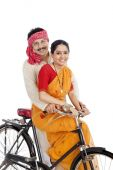 Couple riding a bicycle — Stock Photo