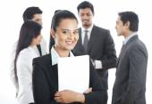 Portrait of a businesswoman smiling with her colleagues in the b — Stock Photo