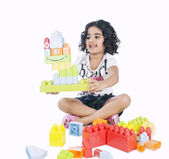 Girl playing with building blocks — Foto de Stock
