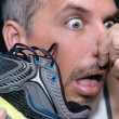 Man Gags After Smelling Shoe — Stock Photo #78248318
