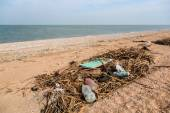 Pollution: garbages, plastic, and wastes on the beach after winter storms. Azov sea. Dolzhanskaya Spit — Stock Photo