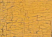 Cracked wooden surface yellow background — Stock Photo