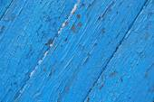 Cracked wooden surface  blue background — Stock Photo