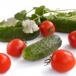 Cucumbers, tomatoes and greens — Stock Photo #68385725