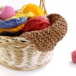 Wicker basket with balls of yarn and knitting needles — Stock Photo #68452035