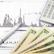 Stock graph report with calculator, pen and usd money for business — Stock Photo #55981545