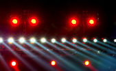 Concert lighting against a dark background from the stage — Stock Photo