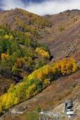 Road to autumn mountain at Xinjiang, china — Stock Photo