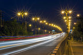 Busy traffic on the bridge at twilight time, Blurred Photo bokeh — Стоковое фото