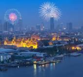Firework over panorama around Grand palace at twilight river sid — Stock Photo