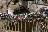 Love locks hang under the Charles Bridge in Prague — Stock Photo
