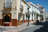 Typical street with white houses in the touristic town of Nerja, Spain — Foto Stock