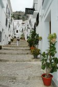 Traditional Spanish white village of Frigiliana with typical stairs — Stock Photo