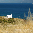 Small white church on the Aegean coast — Stock Photo #63750751