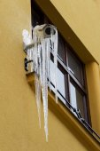 Thawing icicles on security camera — Stock Photo