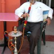 The older man smokes a hookah — Stock Photo #66752503