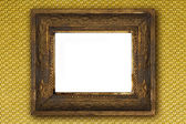 Classic old wooden picture frame carved by hand on gold wallpaper background — Foto de Stock