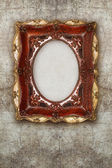 Old picture frame handmade ceramic on wall ruined background  — Photo