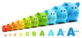 Energy class efficiency scale savings of colorful piggy bank — Stock Photo