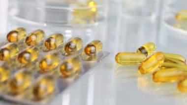 Vitamins supplements pills omega 3 on table — Stock Video