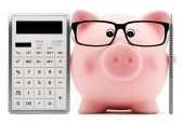 Piggy bank with glasses calculator and pen — Stock Photo