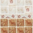 Brown marble tiles with floral decorations — Stock Photo #60611737
