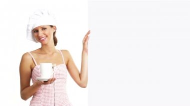 Chef woman with cup showing indicate white billboard, coffee, tea, chocolate marketing concept — Stock Video